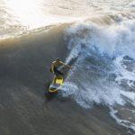 Noosa-plumber SUP surfing